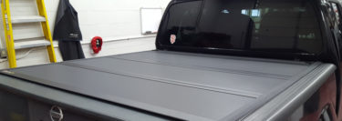 Nesquehoning Client Upgrades 2013 Nissan Frontier with Bed Cover